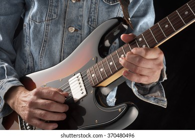 playing country music with an eelctric guitar