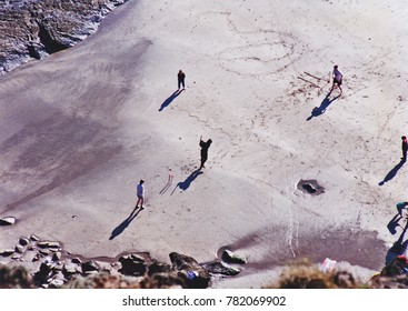 Playing cricket on beach in Wales