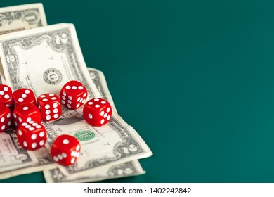 Playing Dices and Stack of American Dollars Bills.