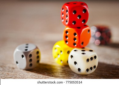 Playing dices in various colours / table game - strategy, coincidence and luck