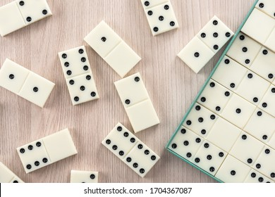 Playing dominoes on a wooden table