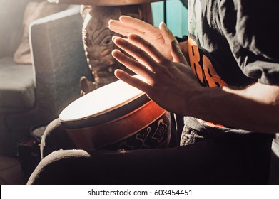 Playing the drum. Hands with a drum. another view. african, bang, beat, child, class, drum, drummer, fingers, hand, hit, instrument, kid, music, musical, percussion, play, rhythm, ring, sound.