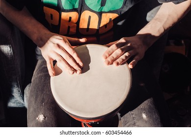 Playing the drum. Hands with a drum. closeup. percussion, instruments, musical, drum, african, child, african, background, band, bang, beat, celebration, class, culture, drummer, festival