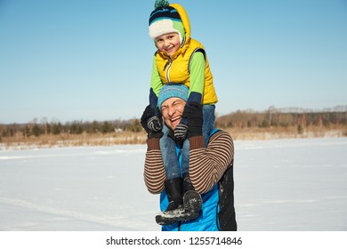 playing father and son in the winter outdoors