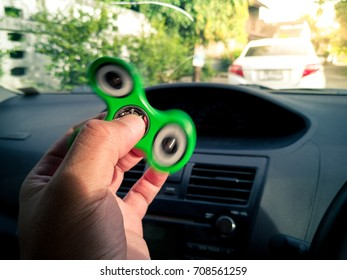 Playing fidget spinner in car while traffic jam