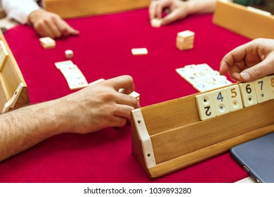 playing field of rummy card game on wooden table