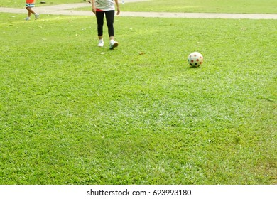 Playing football in the park