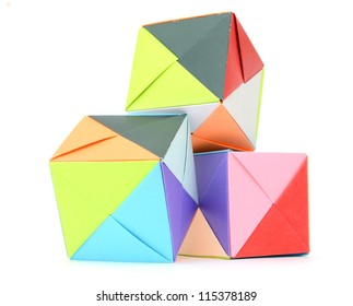 Playing geometric cubes in origami form