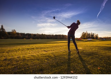 Playing golf in autumn evening during golden hour in Lithuania