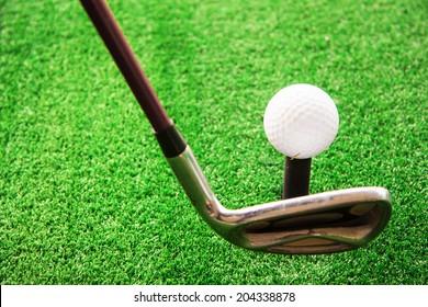 Playing golf. Golf club and ball
