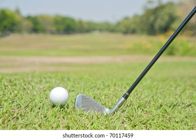 Playing golf. Golf club and ball. Preparing to shot,in the hole.copy Space for text And Public Relations