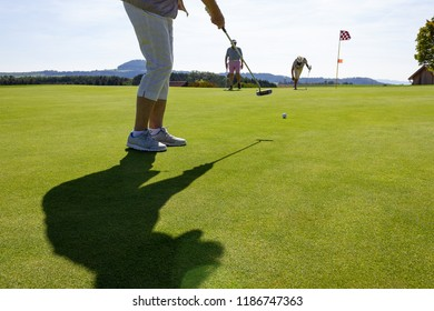 playing golf on summer day and green lawn in south german countryside