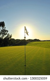Playing golf at sunset. Holidays in Spain