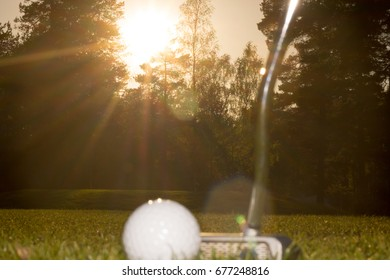 playing golf in sweden Stockholm in sunset
