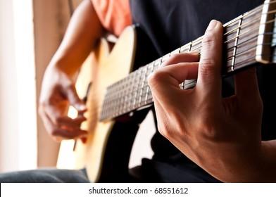 playing guitar Bm chord