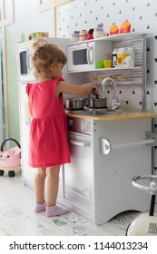 Playing in a kitchen