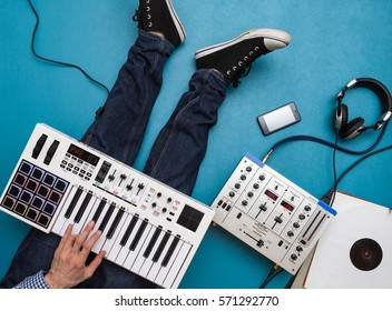 Playing Music Concept, Using Keyboard at Home Studio,