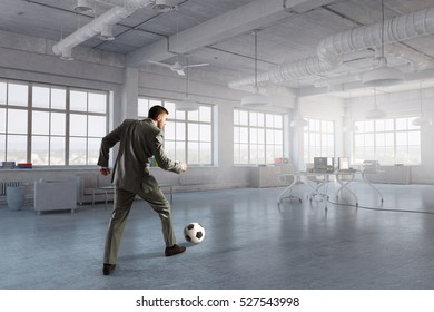 Playing office soccer . Mixed media