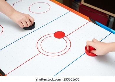 Playing on air hockey at home