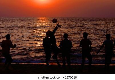 Playing on the beach (Goa, India).