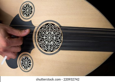 Playing oud.