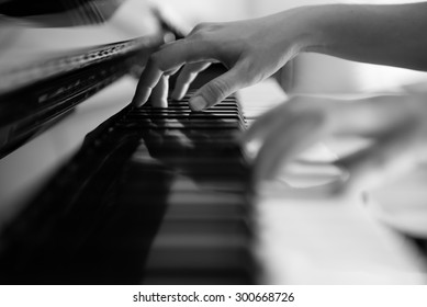 Playing Piano in Black and White Tone (Soft Focus)