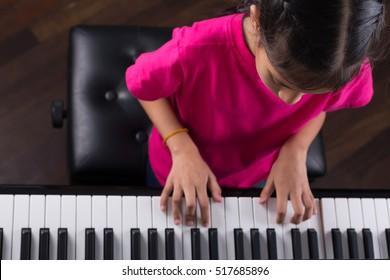 Playing piano /Girl playing piano/grand piano/music instrument