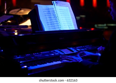 Playing the piano in a night club