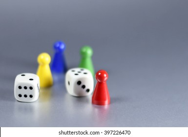 Playing pieces and dice, isolated grey background