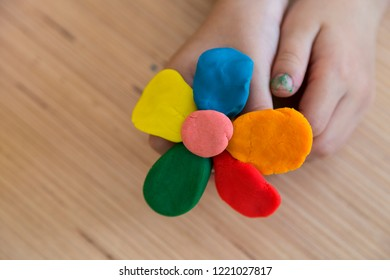Playing with play dough for children's activities in preschool or nursery.creative ideas for child development.back to school and happy teachers day concept.make colorful flower.