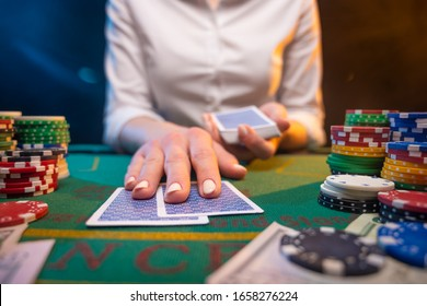 Playing poker or blackjack. Casino, playing in a night club.