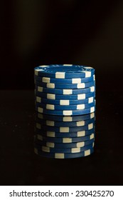 Playing Poker Chips in reflective black background