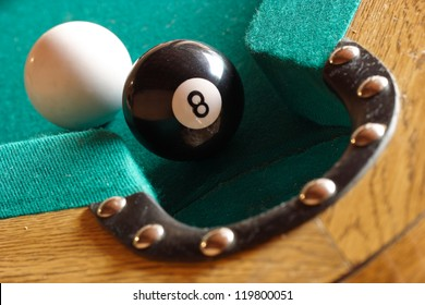 Playing pool, the eight ball is going to fall.
