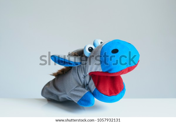 playing puppet on the white background. reaction. Emotional. Hippopotamus.