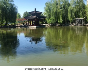 Playing with the reflection in a traditional Chinese park