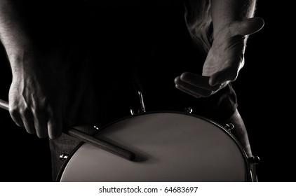 playing repinique (rep; repique; two-headed Brazilian drum);  toned monochrome image;