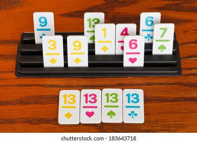 playing in rummy card game on wooden table - group of cards