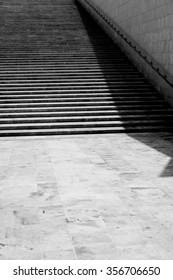 playing with shadows on a sunny day at the stone stairs in Valletta Malta  / The stairs