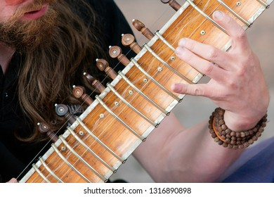Playing sitar ..Idian musical instrument. Close-up