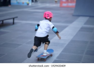 blured people is playing surfskate or skateboard at Bangkok, Thailand