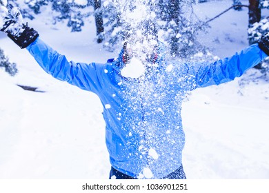 Playing with snow during trekking in the forest
