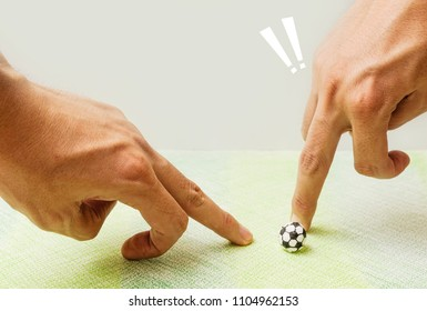 Playing socker made by paper with  fingers,The human use fingers slice paper football,Dangerous while playing football