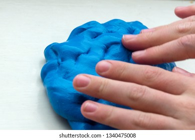 Playing with some gooey homemade blue butter slime