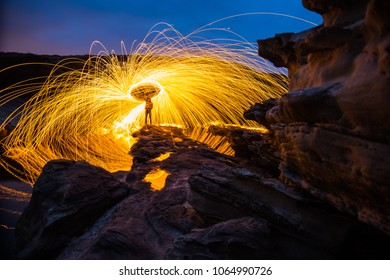 Playing with steel wool at a cove in Jaizkibel, Hondarribia, Basque Country.