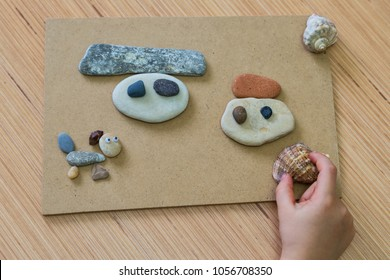 Playing with stones for children's activities in preschool or nursery.