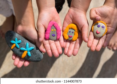 Playing with stones and play dough for children's activities in preschool or nursery.year of education and training