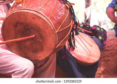Playing traditional drum in a village on ocassion of a marriage celeberation-image