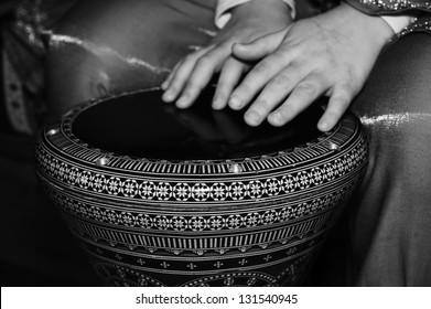 playing a Turkish darbuka