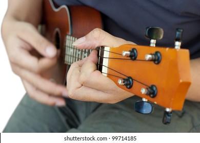 playing ukulele soft focus