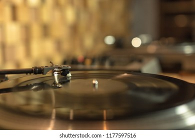 Playing vinyl in the studio on blurred background